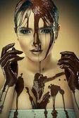 Girl in chocolate — Stock Photo