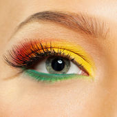 Female eye with bright colors. — Stock Photo