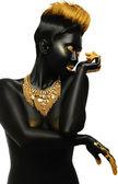 Dark-skinned with golden decor — Zdjęcie stockowe