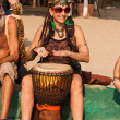 Stock Photo: Unidentified womin carnival costume plays djembe drum at annual festival of Freaks, Arambol beach, Goa, India