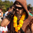 A man in a necklace of flowers and sun glasses talking on the phone at the annual festival of Freaks, Arambol beach, Goa, India, February 5, 2013. — Stock Photo #29877145
