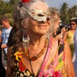An older woman dressed as a hippie and a half mask at the annual festival of February, Arambol beach, Goa, India, February 5, 2013. — Stock Photo