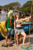 Unidentified man and woman in strange costumes at the annual festival of Freaks, Arambol beach, Goa, India, February 5, 2013. — Stock Photo