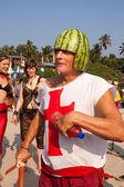A man in a helmet of watermelon on his head at the annual festiva, Arambol beach, Goa, India, February 5, 2013. — Stock Photo