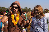 Unidentified man and woman in carnival costumes at the annual festival, Arambol beach, Goa, India, February 5, 2013. — Stock Photo