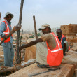 Stock Photo: 16.10.2012 - Jaisalmer. Rajasthan, India. Workers employed on construction of fort.
