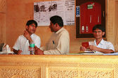 15.10.2012 - Jaisalmer, Rajasthan, India. The hotel's staff and talk behind the reception desk. — Stock Photo
