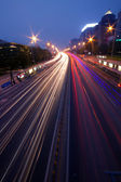 Moving car with blur light through city at night — Stock Photo