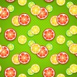 Slices of fresh citrus fruits on green polka dot background. — Stock Vector
