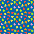 Seamless vintage random colorful heart pattern background — Stock Vector