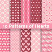 Heart shape vector seamless patterns (tiling) — Stock Vector