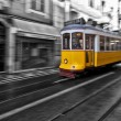 Tram 28 passing through Lisbon streets — Stock Photo #27874707