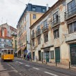 Tram 28 passing through Lisbon streets — Stock Photo #27874711