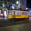 Tram 28 passing through Lisbon streets — Stock Photo #27874991