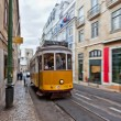 Tram 28 passing through Lisbon streets — Stock Photo #27875285