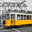 Tram 28 passing through Lisbon streets — Stock Photo #27875295