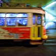 Tram 28 passing through Lisbon streets — Stock Photo #27875319