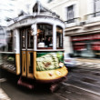 Tram 28 passing through Lisbon streets — Stock Photo