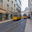 Tram 28 passing through Lisbon streets — Stok fotoğraf