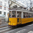 Tram 28 passing through Lisbon streets — Stock Photo #27877693