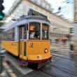 Tram 28 passing through Lisbon streets — Stock Photo #27877727