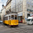 Tram 28 passing through Lisbon streets — Stock Photo #27878993