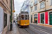 Tram 28 passing through Lisbon streets — Stock Photo