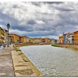 A view of the Arno River, buildings, bridge. Pisa, Italy — Stock Photo