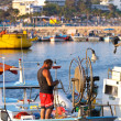 Fisher in a boat fixing his net in Ayia Napa — Stockfoto