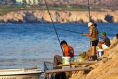 Ayia Napa men fishing — Stock Photo