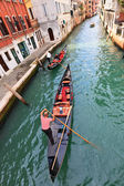 Gondolas on a Venetian canal — Stock Photo