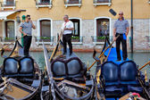 Three gondoliers on their gondolas — Stock Photo