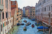 Water traffic on a Venetian canal — Stock Photo