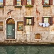 Venice canal and water door — Stock Photo