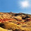 The Painted Hills and Sun at background — Stock Photo