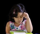 A cute girl is writing her math — Stock Photo
