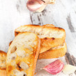 Crusty baguette with garlic. — Stock Photo