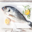 Sea bream with lemon on white tray. — Stock Photo