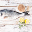 Sea bream on white wooden background. — Stock Photo