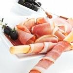 Luxurious prosciutto ham background. — Stock Photo #27175647
