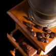 Old vintage coffe mill with ground coffee. — Stock Photo