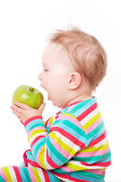 Baby eating green apple. — Stock Photo