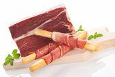 Culinary prosciutto background. — Stock Photo