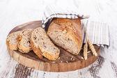 Delicious dark bread background. — Stock Photo