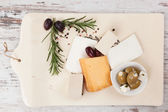 Cheese and olives. Luxurious appetizer. — Stock Photo