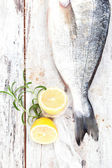 Seafood. Fish with lemon and herbs, top view. — Stock Photo