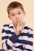 The secret. Finger over mouth. Psst. — Stock Photo