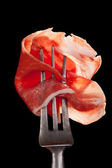 Parma ham detail on fork. — Stock Photo