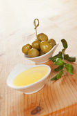 Olive oil wooden background. — Stock Photo