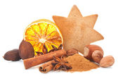 Gingerbread star shaped cookie and orange slice. — Stock Photo